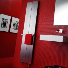 loft radiator placed on a red wall